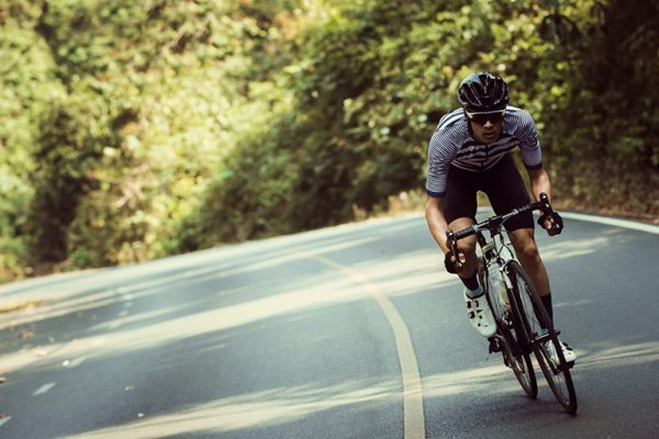 Man cycling bike or bicycle. 6 ways a chiropractor can help your bike ride